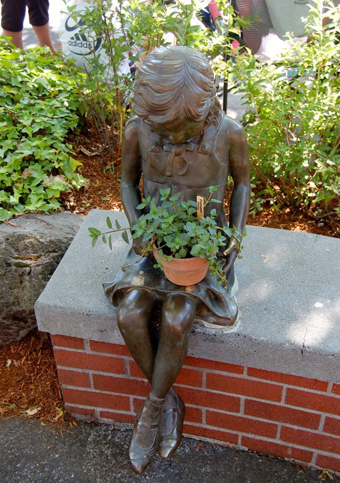 little bronze girl with plant